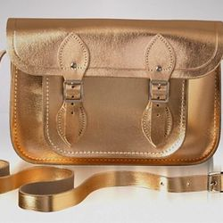 """<a href=""""http://www1.bloomingdales.com/shop/product/the-cambridge-satchel-company-satchel-metallic-11?ID=671442&CategoryID=17426&LinkType=#fn%3Dspp%3D24"""">The Cambridge Satchel Company</a>, $117.60 (was $210.00)"""