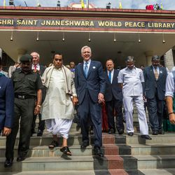 Elder D. Todd Christofferson, center, a member of the Quorum of Twelve Apostles for The Church of Jesus Christ of Latter-day Saints, leaves for the award ceremony at the MIT World Peace University in Pune, Maharashtra, India, on August 14, 2017.