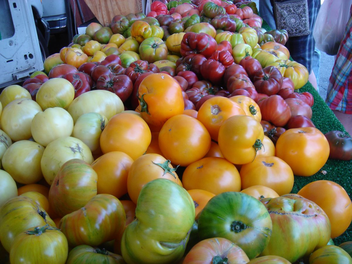 A variety of apples sits out for sale at a stand at the South Pasadena Farmers Market in California.