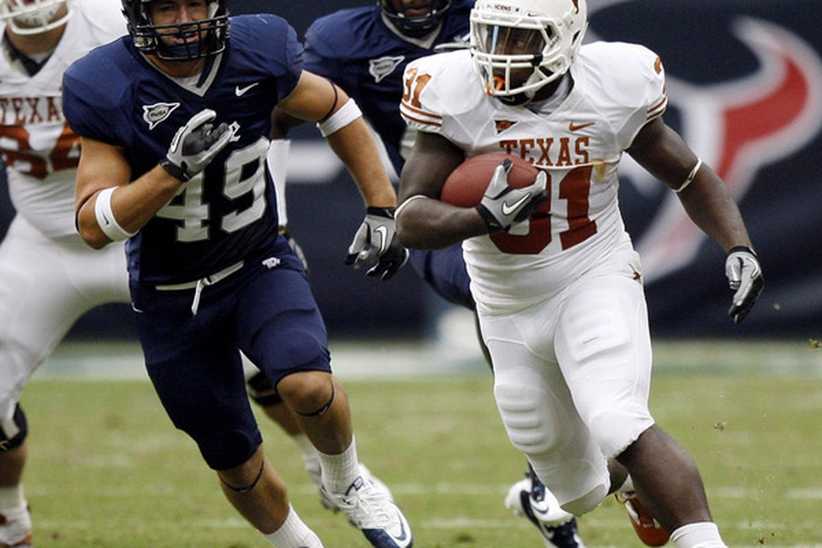 HOUSTON - SEPTEMBER 04:  Running back Cody Johnson #31 of the Texas Longhorns rushes past linebacker Trey Briggs #49 of the Rice Owls in the second quarter at Reliant Stadium on September 4 2010 in Houston Texas.  (Photo by Bob Levey/Getty Images)