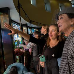 """Barbara Barrington Jones, right, and her granddaughter look at the newly unveiled the """"Roots of Knowledge"""" stained glass window display at the Utah Valley University library on Friday, Nov. 18, 2016, in Orem."""