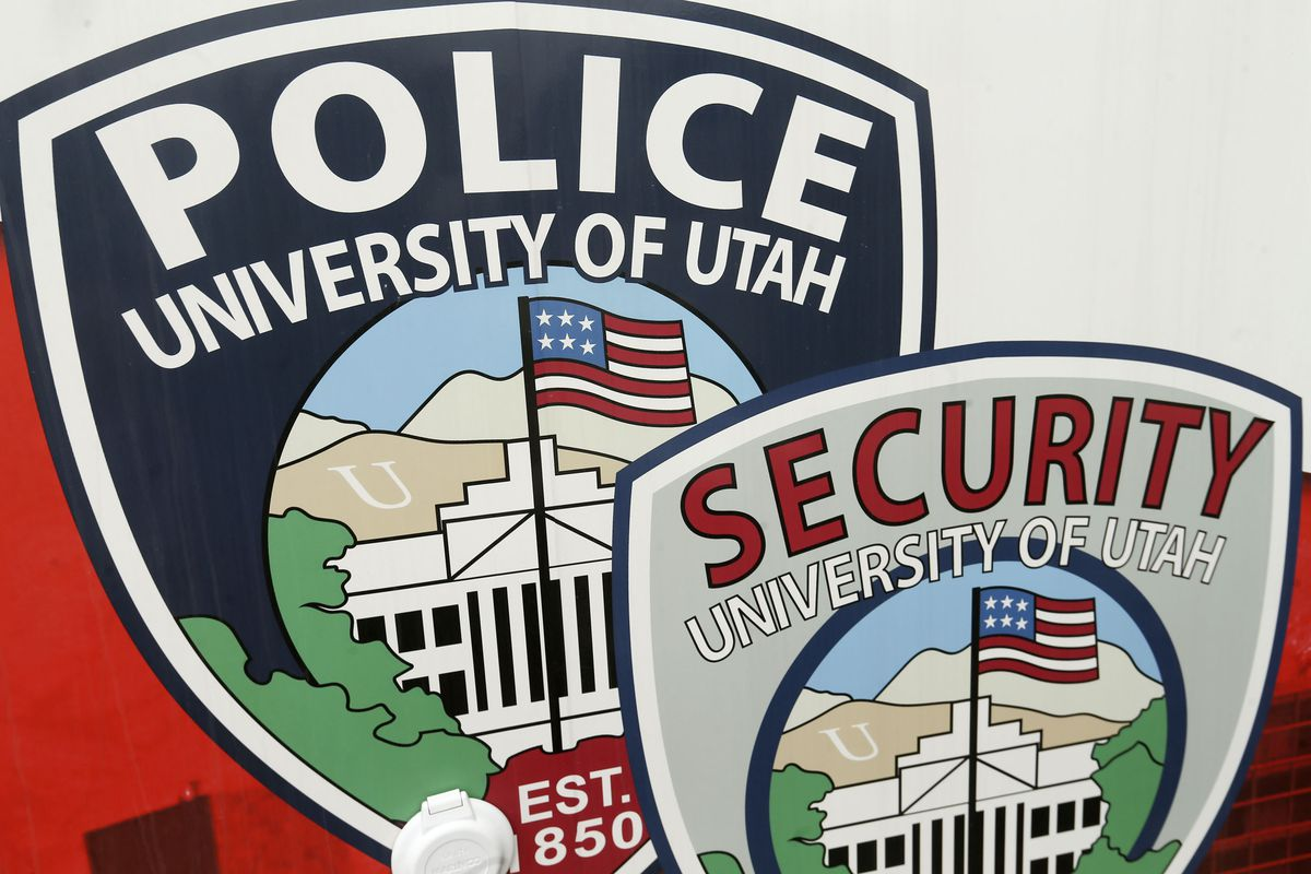 Police and security services emblems are pictured at the University of Utah in Salt Lake City on Friday, April 16, 2021. A proposal that calls for implicit bias and de-escalation training for campus police officers at public colleges and universities will advance to the full Utah Board of Higher Education.