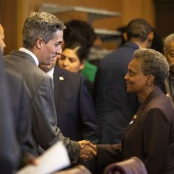 Ald. Daniel La Spata (1st) shakes hands with Mayor Lori Lightfoot before the start of their first Chicago City Council meeting at City Hall, Wednesday, May 29, 2019.