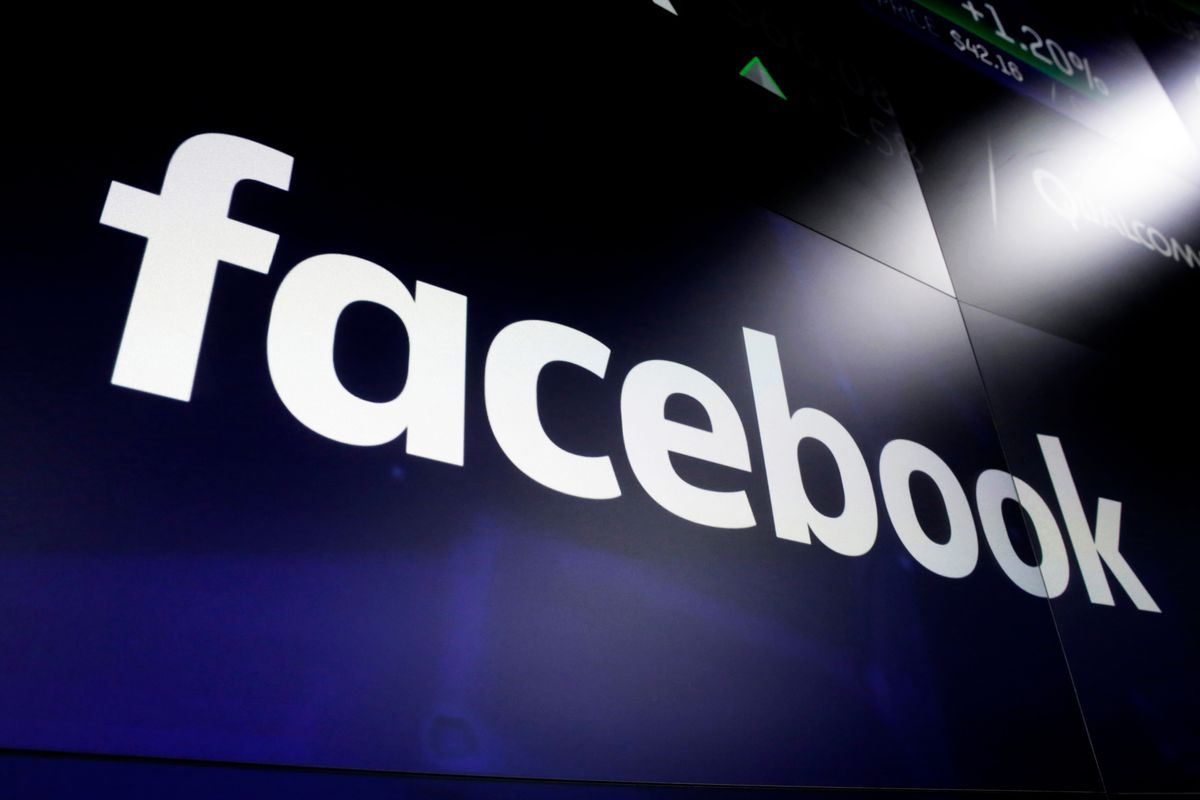 This March 29, 2018, file photo shows the Facebook logo on screens at the Nasdaq MarketSite in New York's Times Square. Facebook on Tuesday, April 28, 2020, reported its slowest quarterly growth as a public company, pressured by a global slowdown in the digital advertising market due to the coronavirus pandemic.