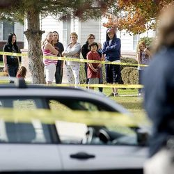 Residents of the apartments watch as West Valley police officers investigate a shooting Friday, Nov. 2, 2012. An additional 26 criminal cases investigated by the embattled West Valley Police Department were dismissed on Friday, bringing the total number of dismissed cases to 124.