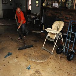 Michelle Smith and Chris Smith help clean up their father's home in LaPlace, La., Friday Aug. 31, 2012, after it was flooded by Hurricane Isaac.