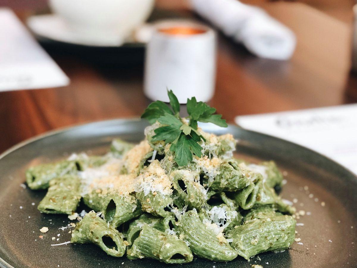A bowl of green noodles at Giulia.