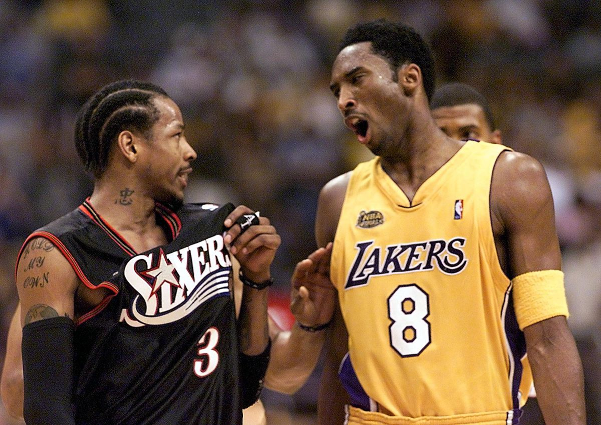 Allen Iverson (L) of the Philadelphia 76ers and Ko