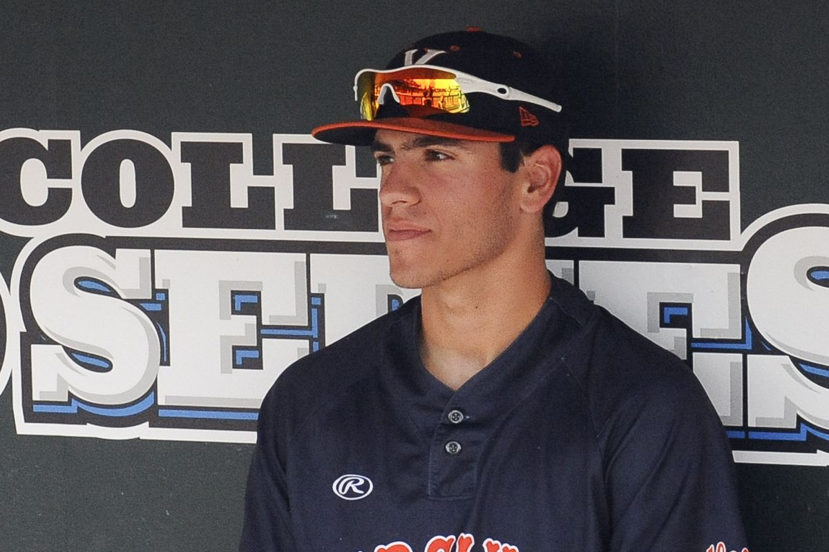 Freshman LHP Adam Haseley sits in the dugout awaiting his start in Game 2 of the College World Series.