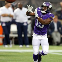 Aug 9, 2013; Minneapolis, MN, USA; Minnesota Vikings wide receiver Greg Jennings (15) catches a pass during pre game before a game against the Houston Texans at the Metrodome.