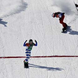 From left, bronze medal winner Eva Samkova, of the Czech Republic, gold medal winner Michela Moioli, of Italy, silver medal winner De Sousa Mabileau Julia Pereira, of France, and Chloe Trespeuch, of France, cross the finish line during the women's snowboard finals at Phoenix Snow Park at the 2018 Winter Olympics in Pyeongchang, South Korea, Friday, Feb. 16, 2018.