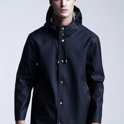 """Stutterheim's raincoat with gold snap buttons. Photo by George Chinsee via <a href=""""http://www.wwd.com/retail-news/department-stores/get-carter-barneys-jay-z-holiday-7183775"""">WWD</a>"""