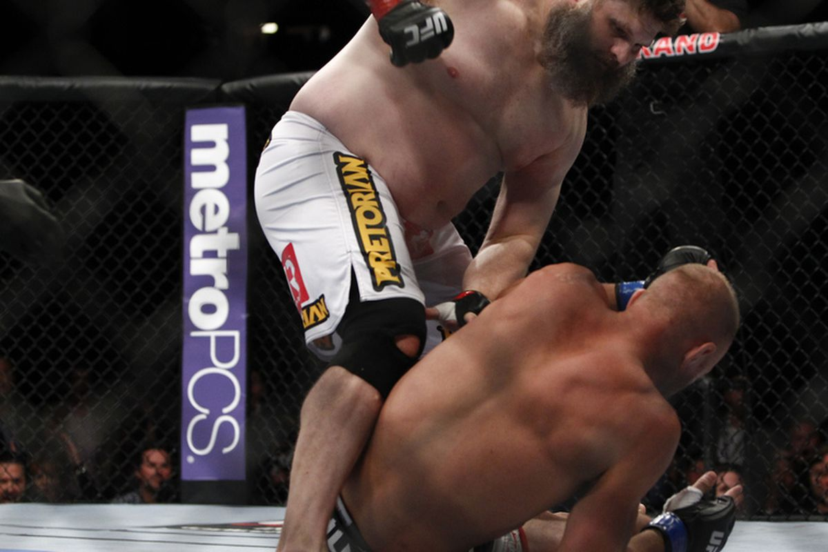 Roy Nelson follows up on a hurt Dave Herman at UFC 146 in Las Vegas, Nevada on May 26, 2012. Photo by Esther Lin via MMAFighting.com.