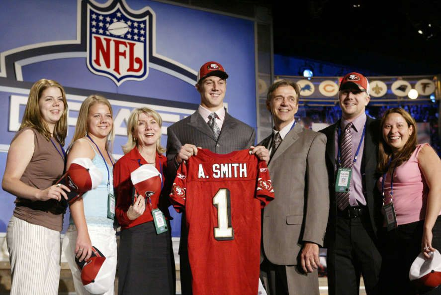 Answer 1 Alex Smith, center, a quarterback from Utah, stands with friends and family after being selected as the No. 1 overall pick by the San Francisco 49ers at the 2005 NFL Draft in New York Saturday, April 23, 2005. (AP Photo/Gregory Bull)