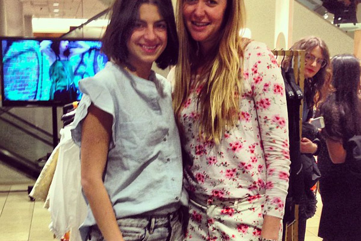 """The <a href=""""http://chicago.racked.com/archives/2012/06/15/man-repeller-is-a-fake.php"""">fake</a> Man Repeller with PJK creative director Chelsey Santry and one very curious shopper in the background"""