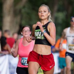 Madey Dickson places second in the women's division of the Deseret News Half Marathon at Liberty Park in Salt Lake City on Friday, July 23, 2021.