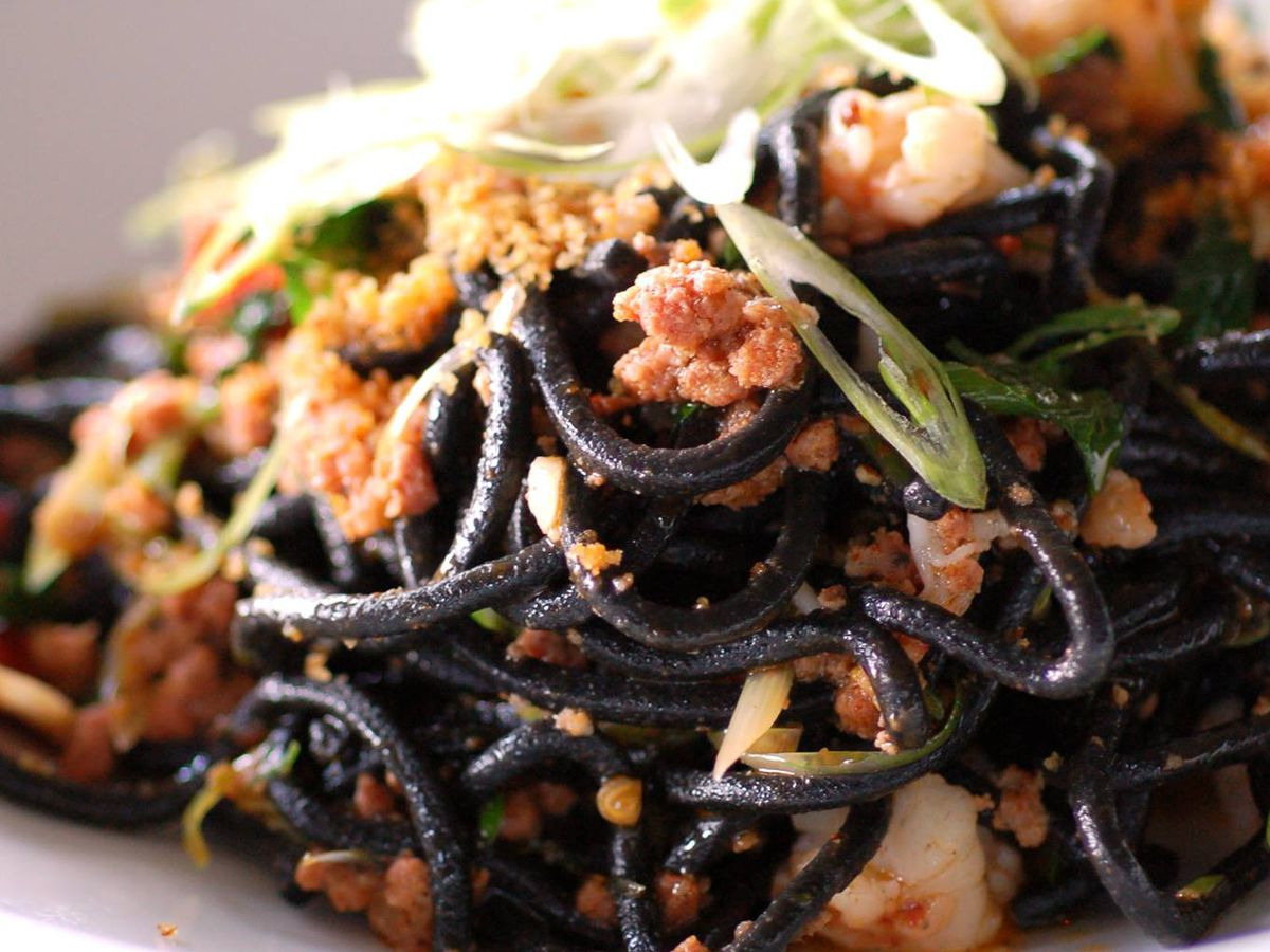 The black spaghetti with hot calabrese sausage, red shrimp, and scallions