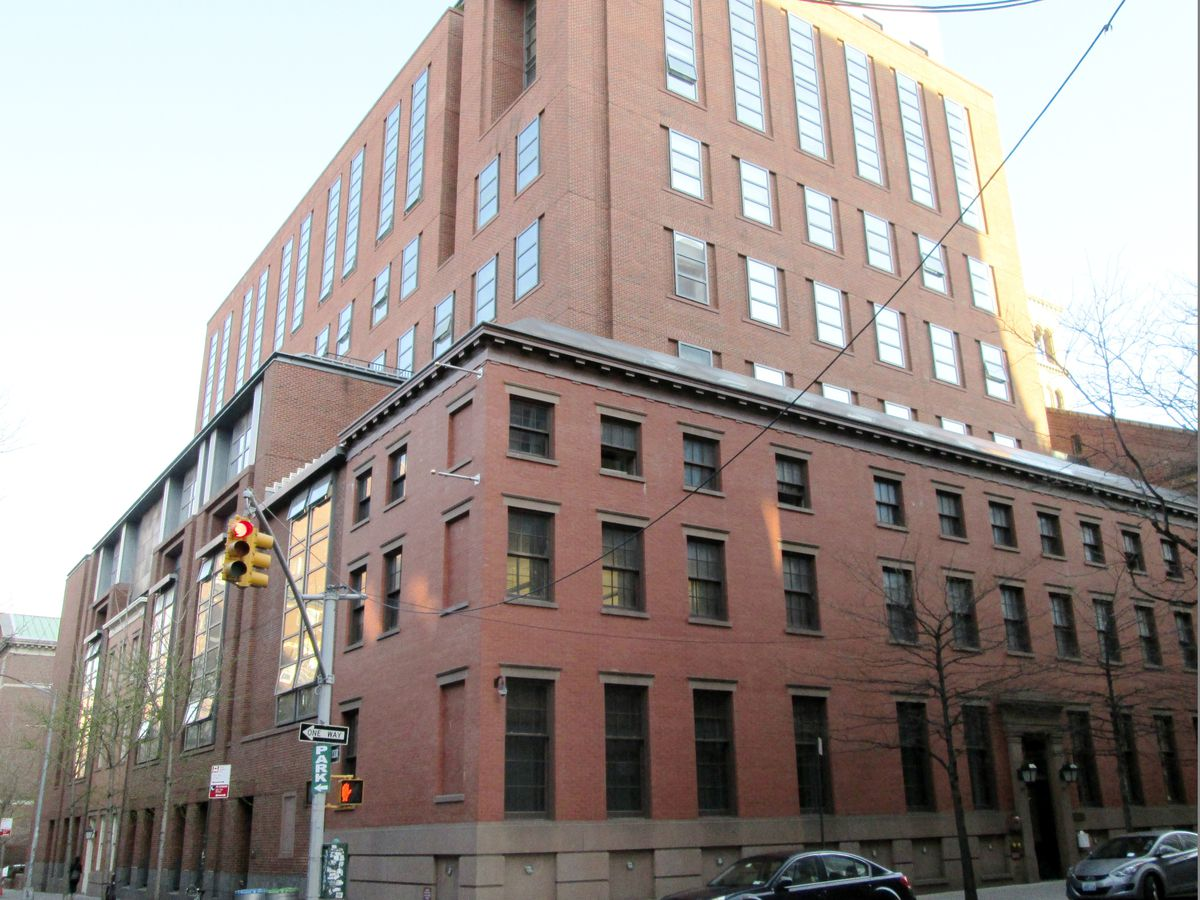 Furman Hall at 85 West 3rd Street, part of NYU. The facade is red brick and there is a terraced level.