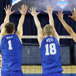 BYU's Davide Gardini, Miki Jauhiainen, and Wil Stanley go up for what turned out to be the match winning point on BYU Pepperdine's Bryce Dvorak in the finals of the Mountain Pacific Sports Federation Championship, at the Smith Field House in Provo on Saturday, April 24, 2021. BYU won in straight sets.