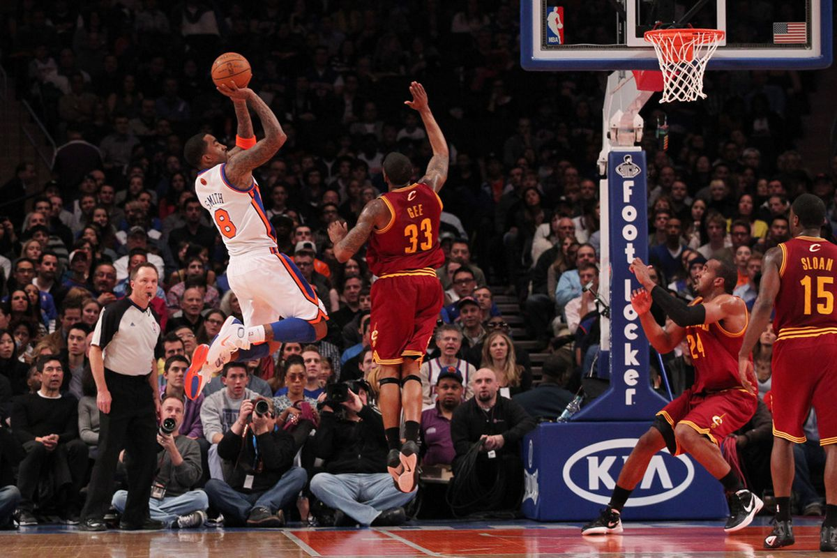 Mar 31, 2012; New York, NY, USA;  New York Knicks shooting guard J.R. Smith (8) shoots over Cleveland Cavaliers small forward Alonzo Gee (33) during the first quarter at Madison Square Garden.  Mandatory Credit: Anthony Gruppuso-US PRESSWIRE