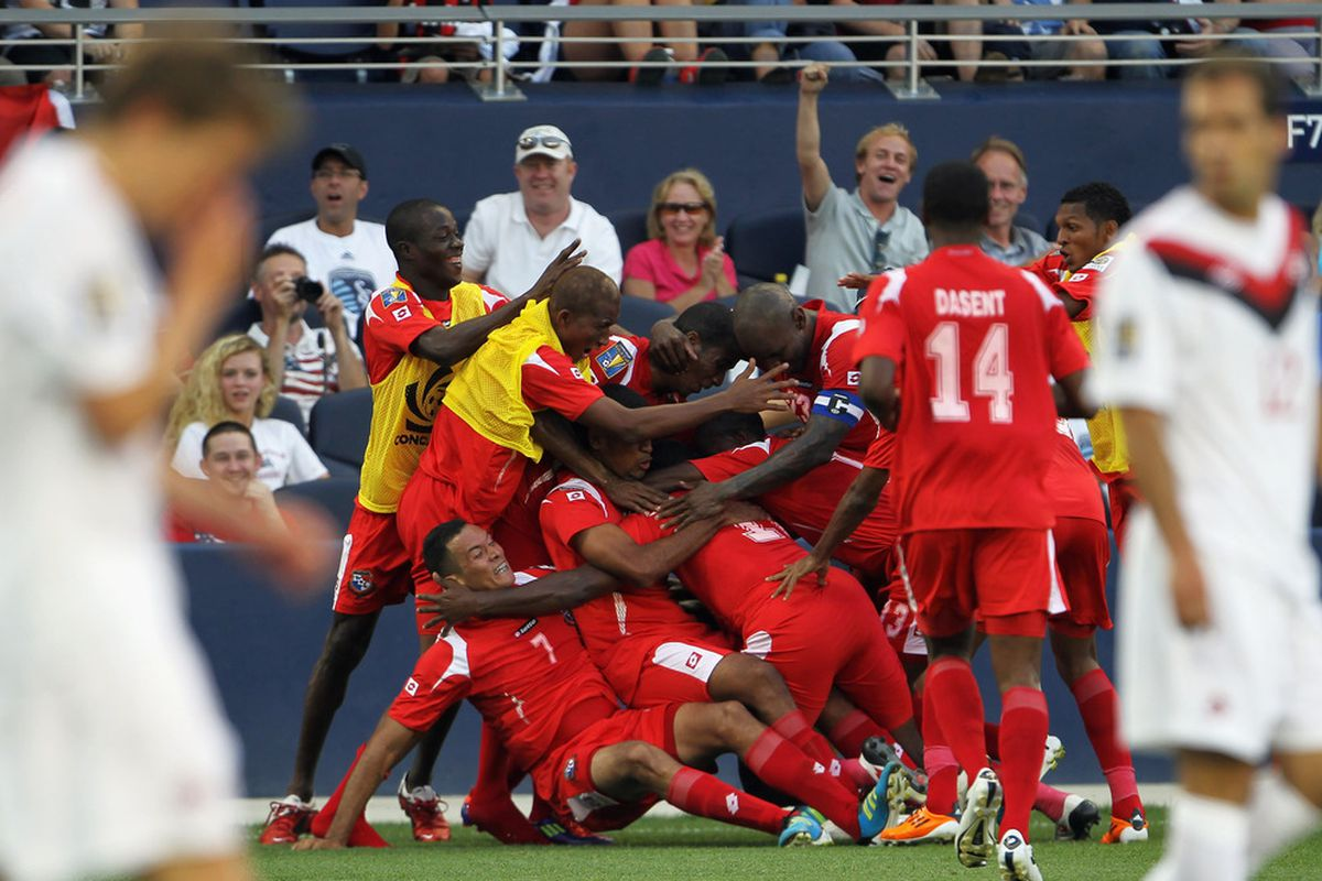 KANSAS CITY, KS - JUNE 14:  Blas Perez #7 of Panama is swarmed by teammates after scoring during the Gold Cup game against Canada. Panama fans are confused by raucous Kansas City support of goal scoring.(Photo by Jamie Squire/Getty Images)