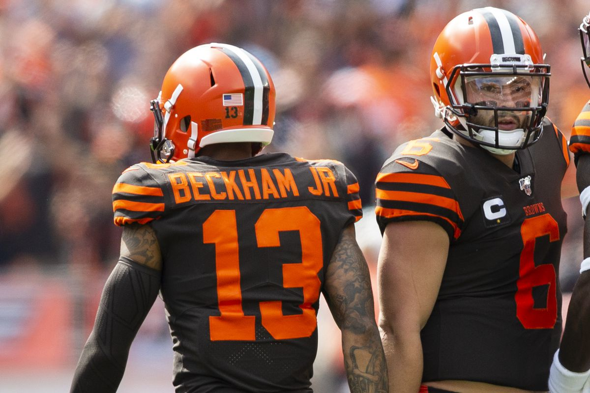 Cleveland Browns quarterback Baker Mayfield congratulates wide receiver Odell Beckham on his first down reception against the Tennessee Titans during the first quarter at FirstEnergy Stadium.