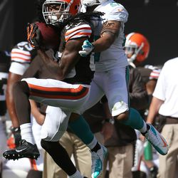 Sep 8, 2013; Cleveland, OH, USA; Cleveland Browns wide receiver Travis Benjamin (80) makes a catch against Miami Dolphins safety Jimmy Wilson (27) during the fourth quarter at FirstEnergy Field. The Dolphins won 23-10.