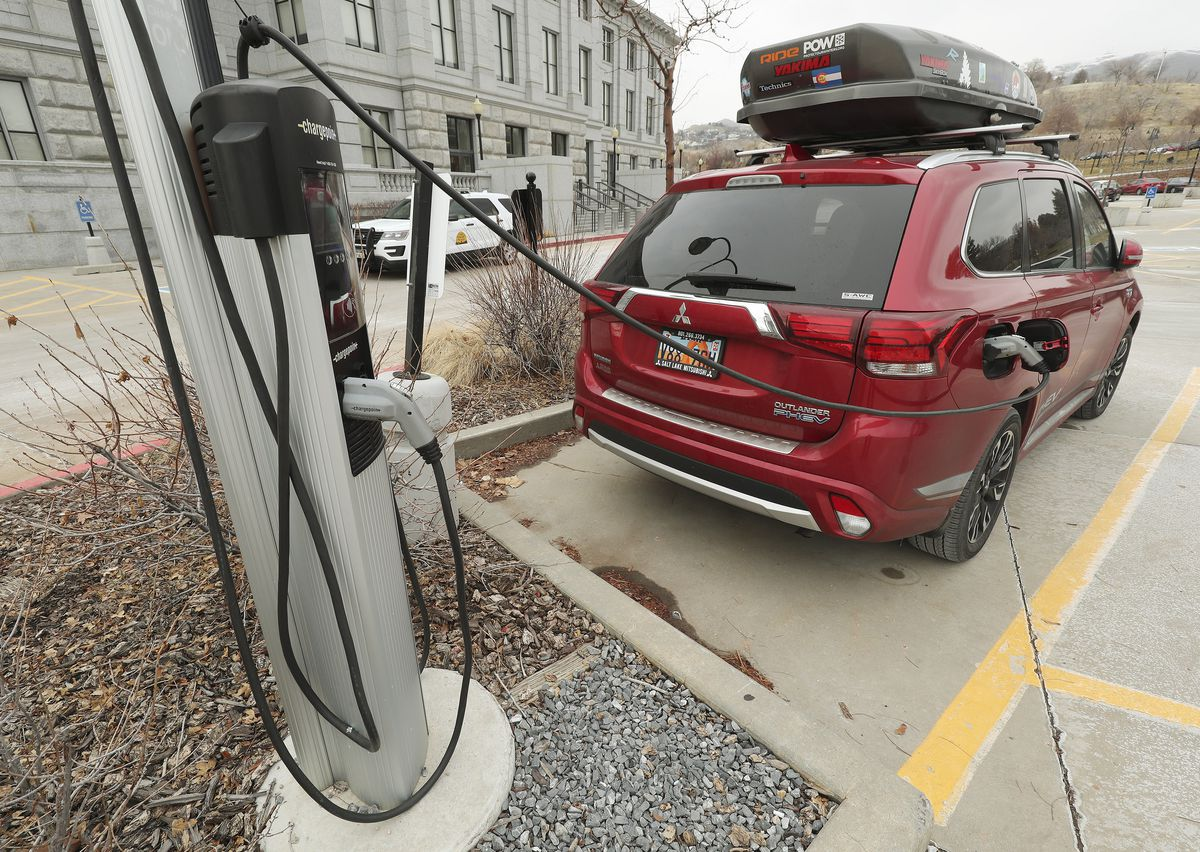 An electric vehicle is charged at the Capitol in Salt Lake City on Tuesday, Dec. 31, 2019.