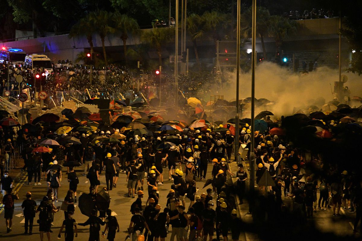 Police fire tear gas to get protesters to disperse near the government headquarters in Hong Kong on July 2, 2019.
