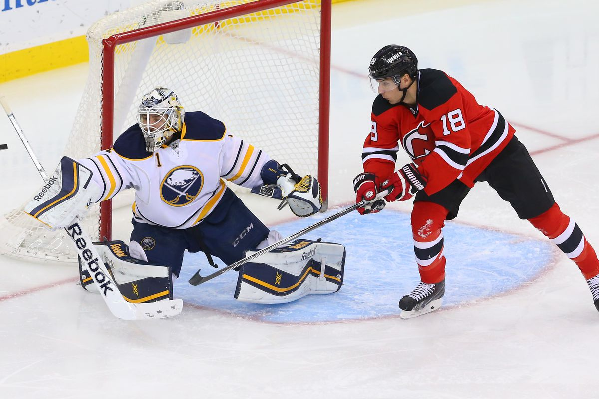 Steve Bernier battles in front of Jhonas Enroth before the Sabres traded him in an attempt to tank even harder.