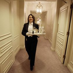 Butler Tamara Nisonova carries a tray of water to a room in New York's St. Regis Hotel, Wednesday, March 14, 2012. A century after the Titanic sank, the legacy of the ship's wealthiest and most famous passenger, John Jacob Astor, quietly lives on at the luxury hotel he built in New York City.