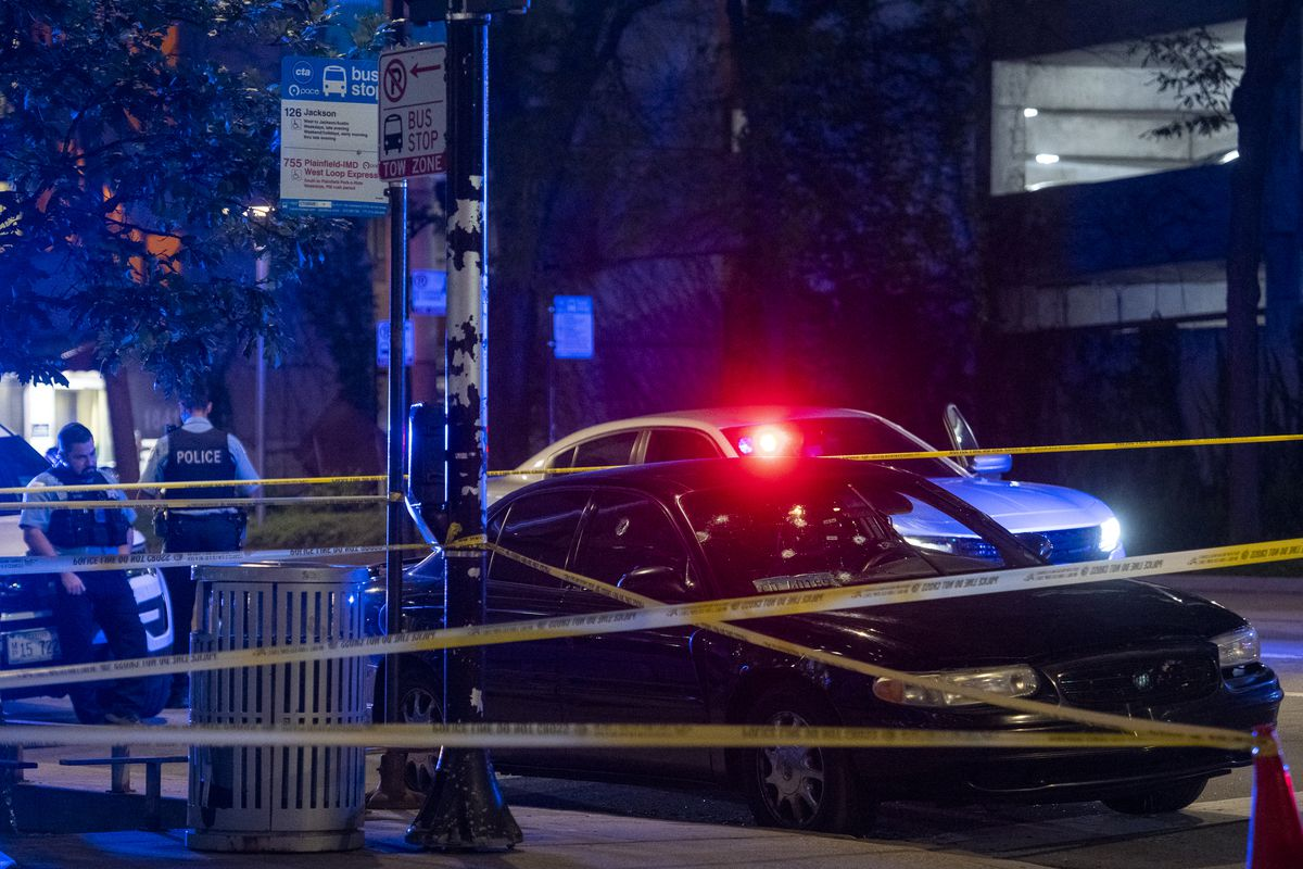 Illinois State Police with help from Chicago Police Department investigate a vehicle parked in front of Rush Hospital with bullet holes all over it, that was involved in a shooting on I-290 near Ashland Avenue where 3 people were shot, 1 fatally, Friday, Aug. 13, 2021.