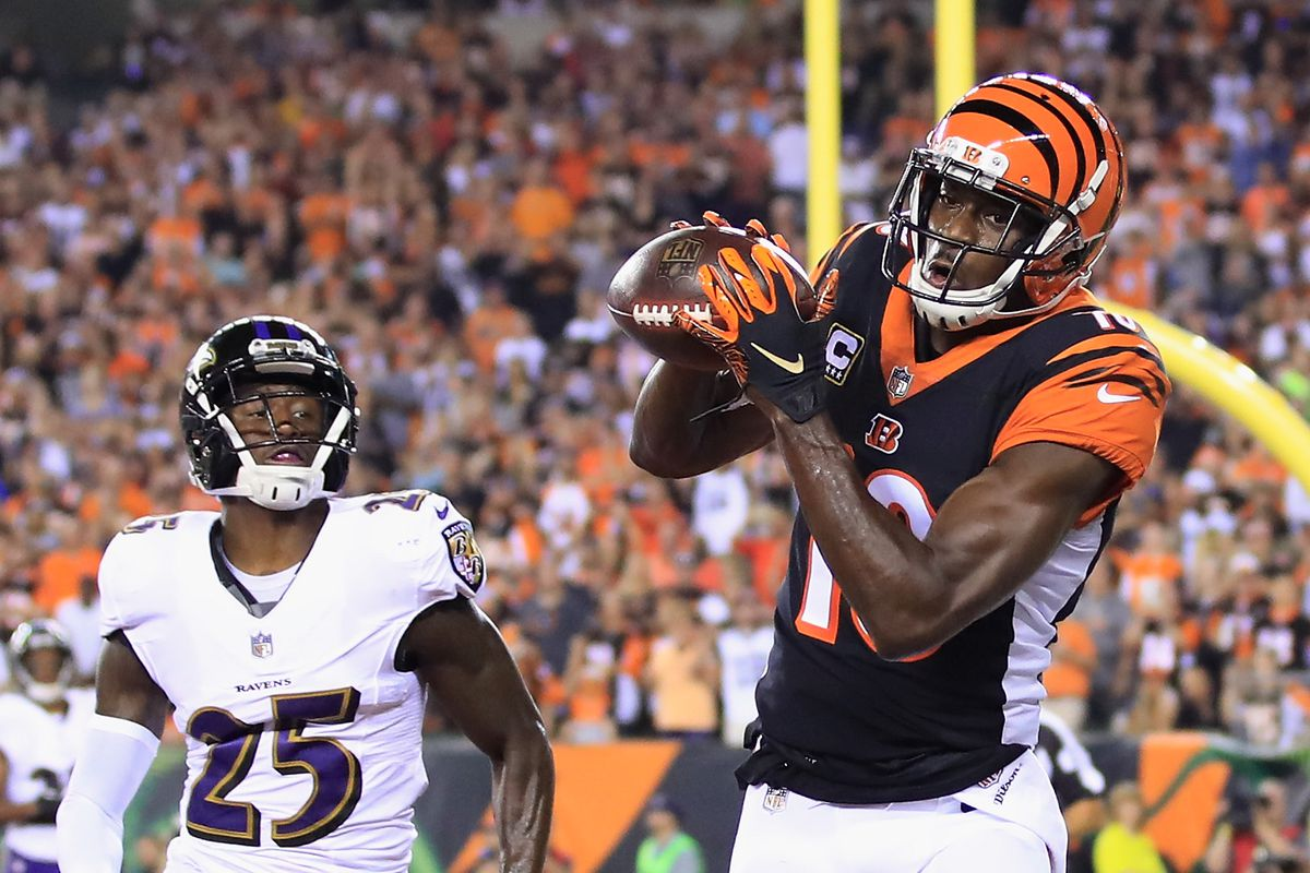 A.J. Green #18 of the Cincinnati Bengals scores a touchdown against Tavon Young #25 of the Baltimore Ravens during the first quarter at Paul Brown Stadium on September 13, 2018 in Cincinnati, Ohio.