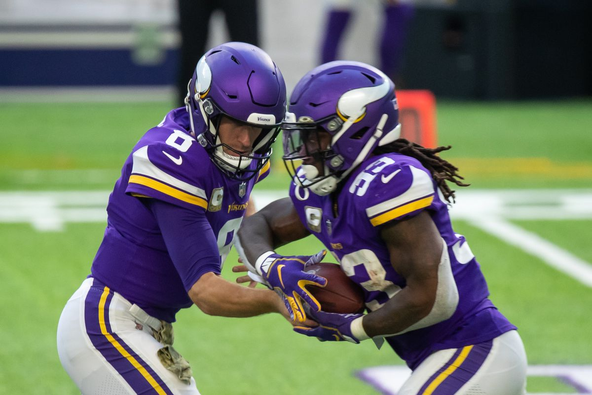 Minnesota Vikings quarterback Kirk Cousins hands the ball off to running back Dalvin Cook against the Detroit Lions in the third quarter at U.S. Bank Stadium.