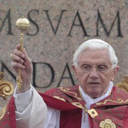 Pope Benedict XVI blesses the faithful during the Palm Sunday mass at St. Peter's square at the Vatican, Sunday, April 1, 2012.