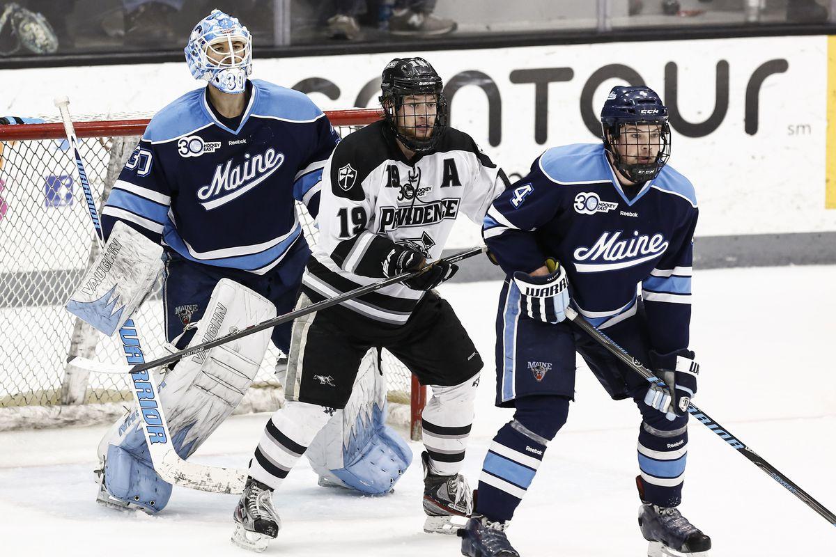 Derek Army (19) sets up shop in front of Maine goaltender Dan Sullivan in the Hockey East Quarterfinals.