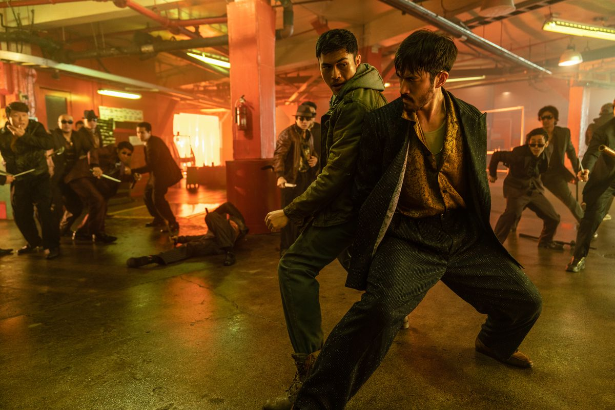 Henry Golding plays Snake Eyes and Andrew Koji plays Tommy/Storm Shadow fend off ninjas in Snake Eyes