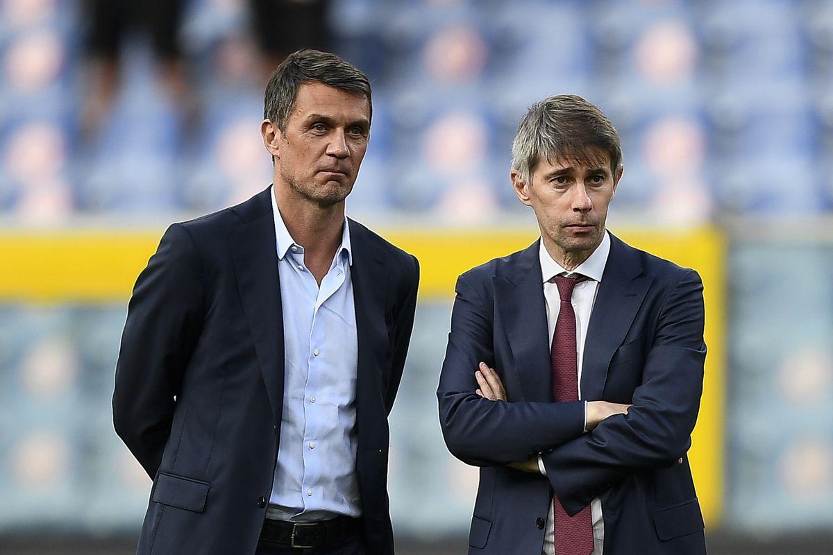 Paolo Maldini (L), technical area director of AC Milan, and...