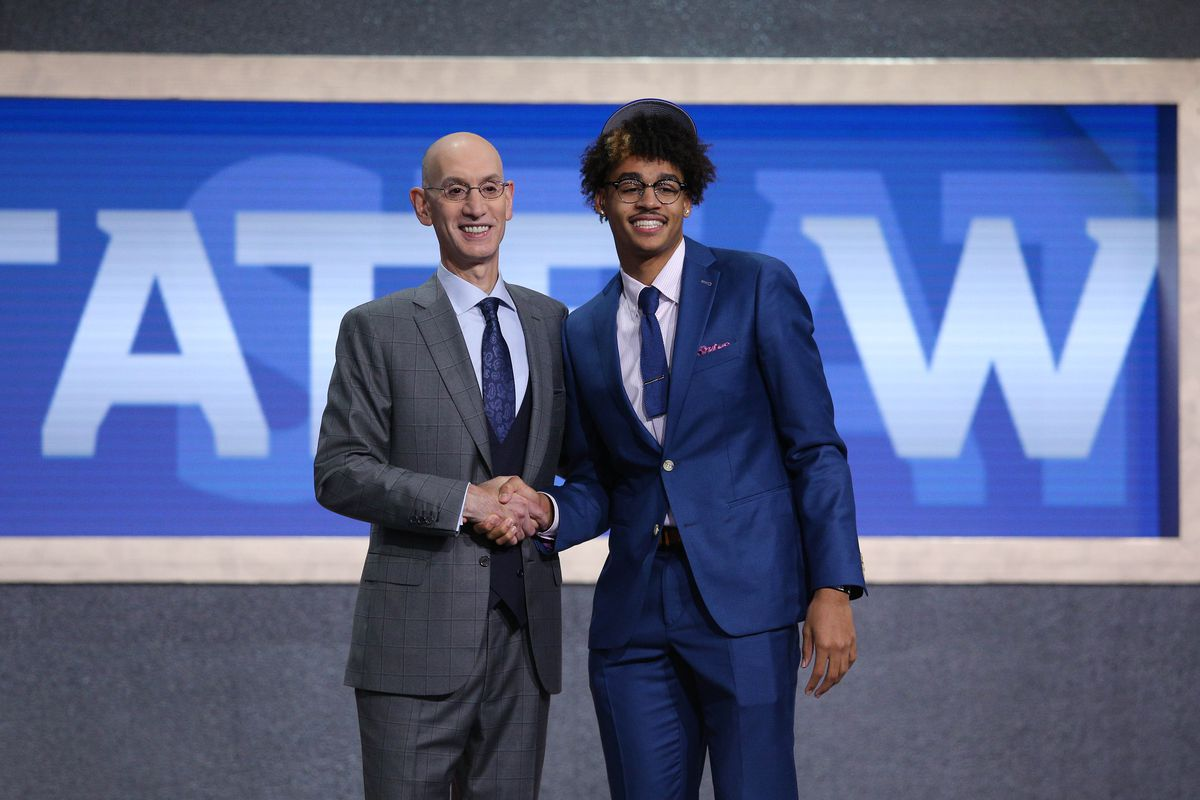 Jordan Poole greets NBA commissioner Adam Silver after being selected as the number twenty-eight overall pick to the Golden State Warriors in the first round of the 2019 NBA Draft at Barclays Center.