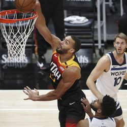 Utah Jazz center Rudy Gobert (27) dunks in Salt Lake City on Saturday, Dec. 26, 2020.
