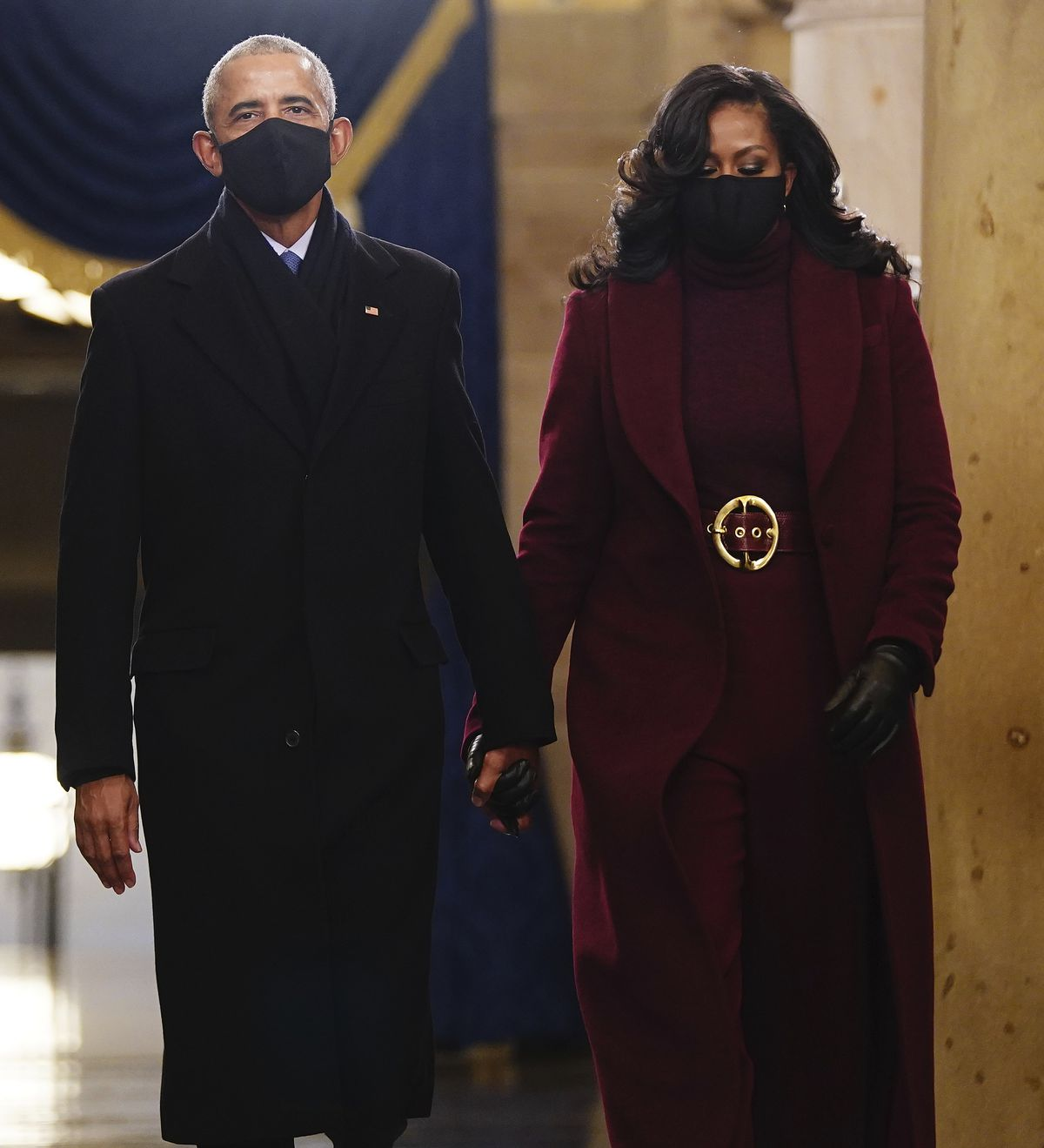 Former President Barack Obama and Michelle Obama arrive in the Crypt of the US Capitol for President-elect Joe Biden's inauguration ceremony on Wednesday, Jan. 20, 2021 in Washington.