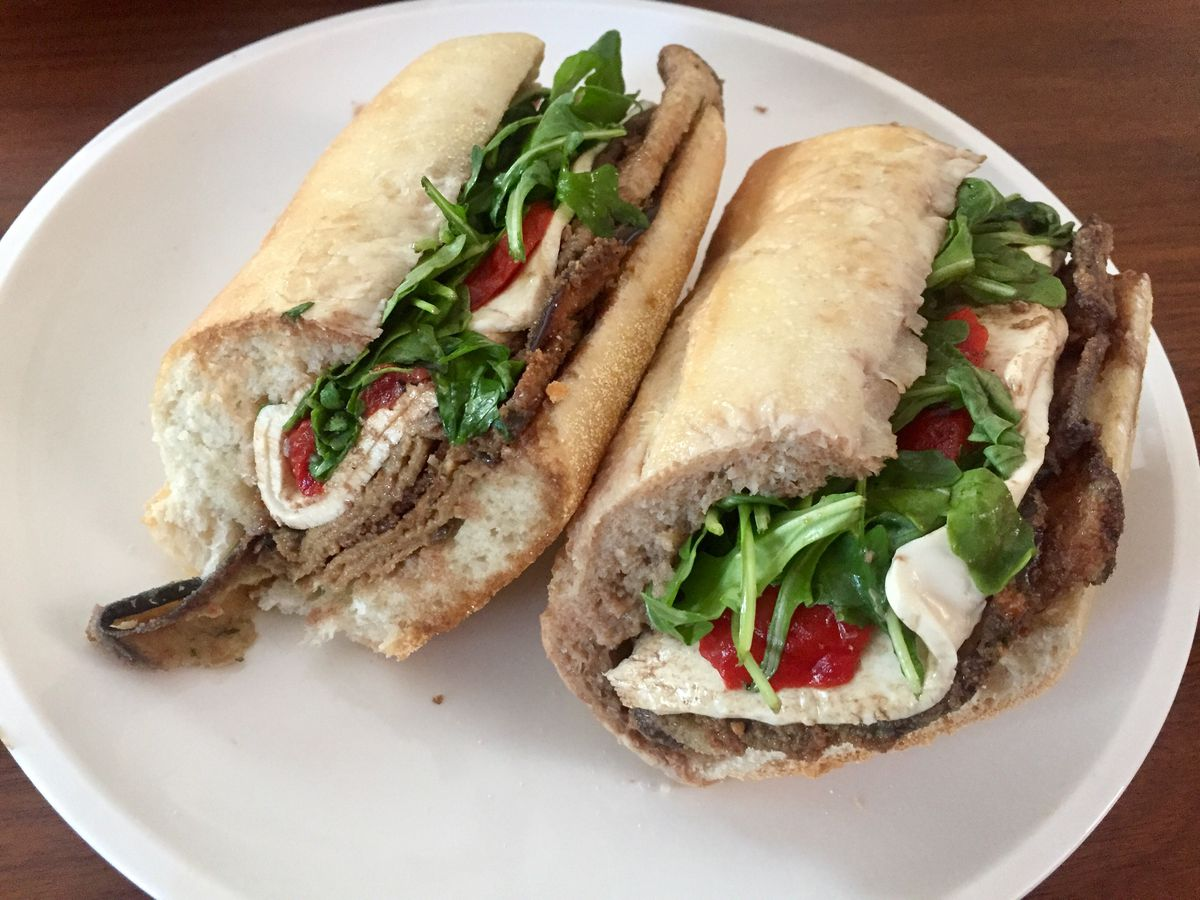A fried eggplant sandwich with mozzarella, roasted red peppers, arugula, and balsamic vinegar from Monmouth Street Deli