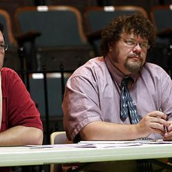 Musical director Trent Oliphant, left, and director Nolan Mitchell listen to an audition.
