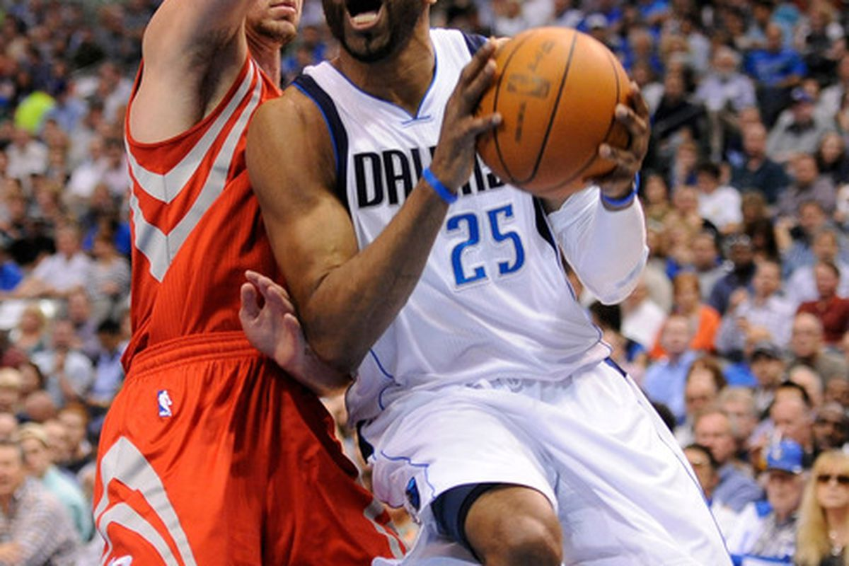 Apr 18, 2012; Dallas, TX, USA; Dallas Mavericks shooting guard Vince Carter (25) drives the ball past Houston Rockets forward Chandler Parsons (25) during the second quarter at the American Airlines Center. Mandatory Credit: Jerome Miron-US PRESSWIRE