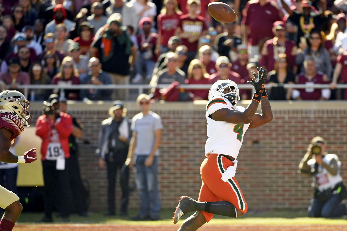 Miami Hurricanes wide receiver Jeff Thomas catches a touchdown pass against the Florida State Seminoles in the first quarter at Doak Campbell Stadium.