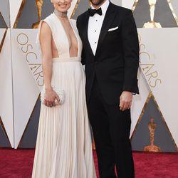 Olivia Wilde wears a very bold suspenders-as-bra Valentino dress alongside Jason Sudeikis. Photo: Jason Merritt/Getty Images