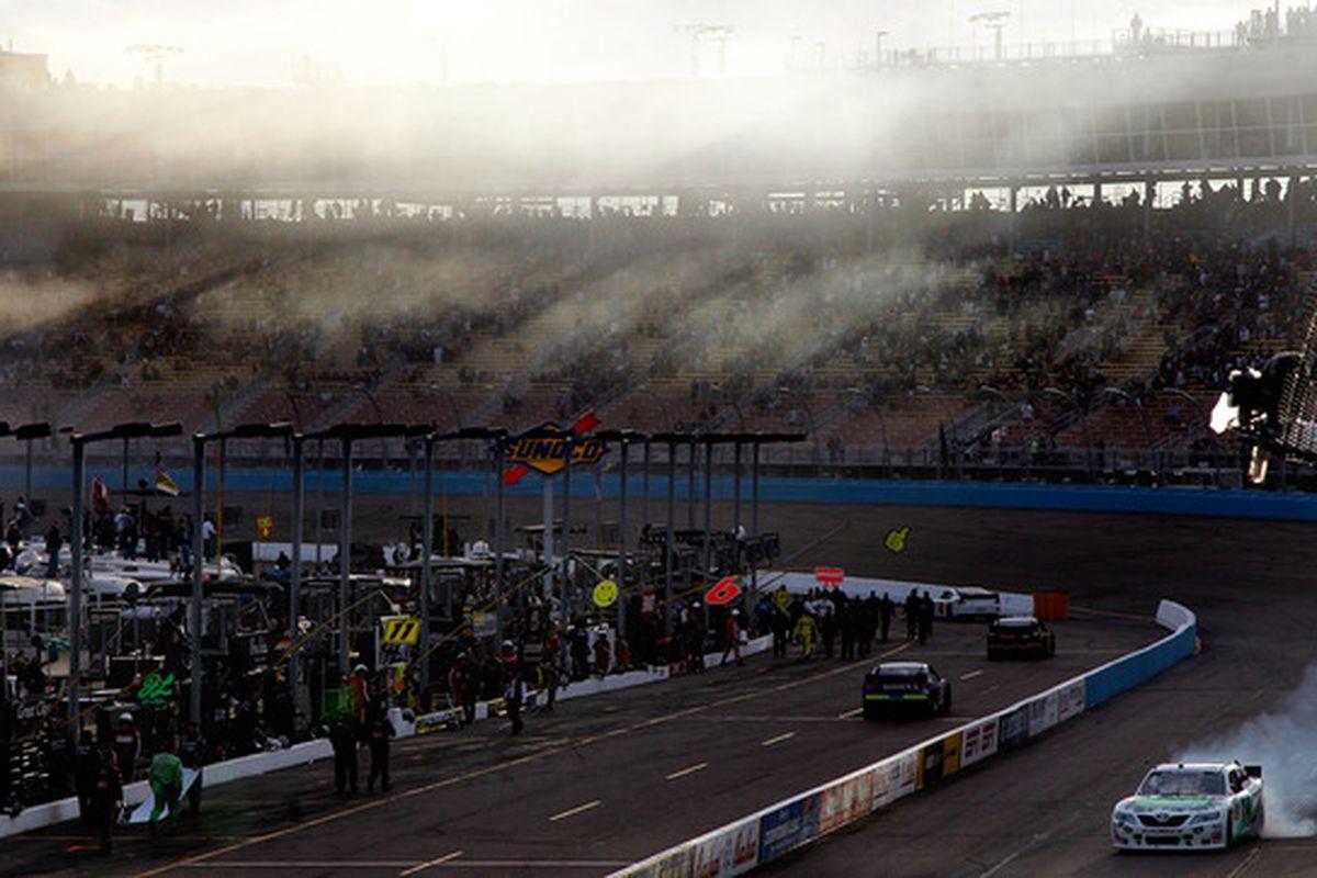 Kyle Busch celebrates with a burnout after winning the NASCAR Nationwide Series Bashas' Supermarkets 200 at Phoenix International Raceway.