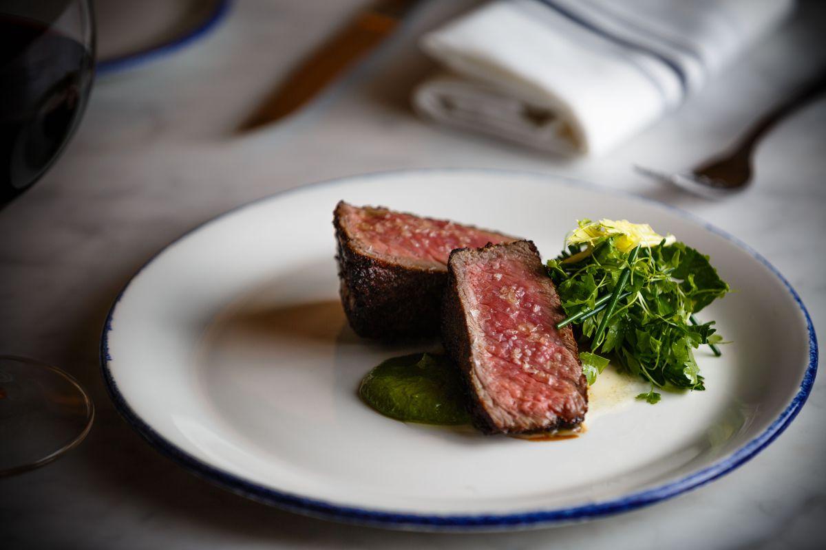 Sirloin steak with herb salad.