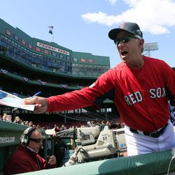 Boston Red Sox manager Bobby Valentine signs an autograph prior to the home opener of the Boston Red Sox against the Tampa Bay Rays in a baseball game at Fenway Park in Boston, Friday, April 13, 2012.