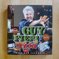 "<a href=""http://eater.com/archives/2011/05/26/guy-fieris-latest-cookbook-reveals-the-evolution-of-guy-fieri.php"" rel=""nofollow"">Guy Fieri's Latest Cookbook Reveals the Evolution of Guy Fieri</a><br />"